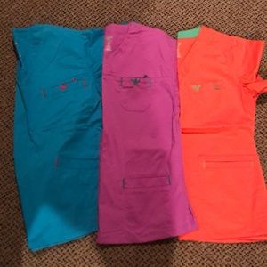 2 Med Couture scrub tops. XS. Like new.